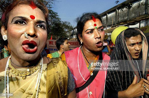 Indian Hijra or transexual mimic felation during a protest march at the 2004 World Social Forum in Bombay 18 January 2004 Antiglobalisation activists...