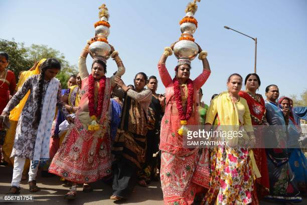 Indian hijras participate in a religious procession in Gandhinagar some 30 km from Ahmedabad on March 22 2017 Hijra is a term used in South Asia...