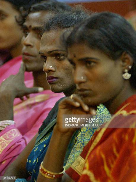 Indian hijraseunuchs listen to an unseen speaker at a public meeting of sexual minorities in Bangalore 16 December 2003 The public meeting organised...