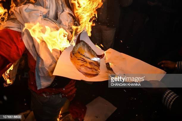 Indian Hindu activists burn effigy of Chief Minister of Kerala Pinarayi Vijayan during a demonstration over two women entering the Sabarimala Ayyapa...