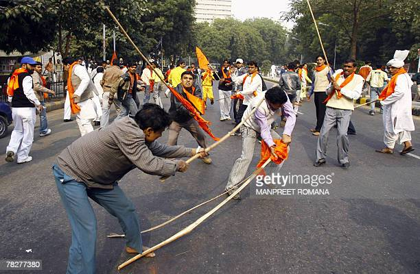Indian Hindu and Muslim activists fight with bamboo canes during a clash between Hindu and Muslim protestors in New Delhi 06 December 2007 on the...