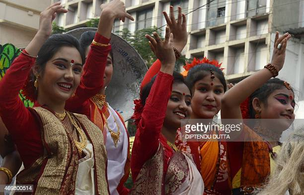 Indian Hindu Bengali girls wear traditional dress during celebrations of the Bengali New Year in Siliguri on April 15 2015 The New Year also marks...