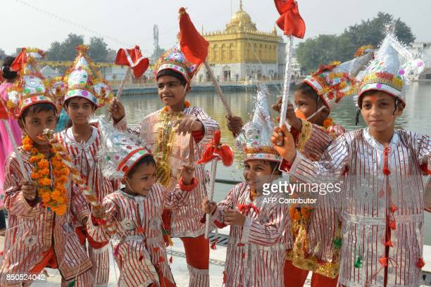 Indian Hindu children dressed as a Langoor monkey to honour the Hindu monkeygod Hanuman pay a visit to Bara Hanuman Temple in Amritsar on September...