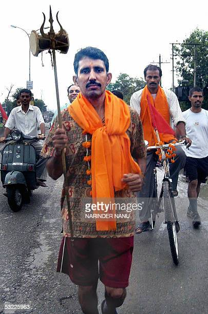 Indian Hindu devotee Kamal Kishore begins his seven day pilgrimage to the Amarnath Cave Shrine some 650 kilometers from Amritsar on 12 July 2005...