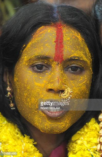 Indian Hindu devotee Swarnaltha who undertook a vow of chastity and devoted her life to the Hindu goddess Mahankali answers questions while allegedly...