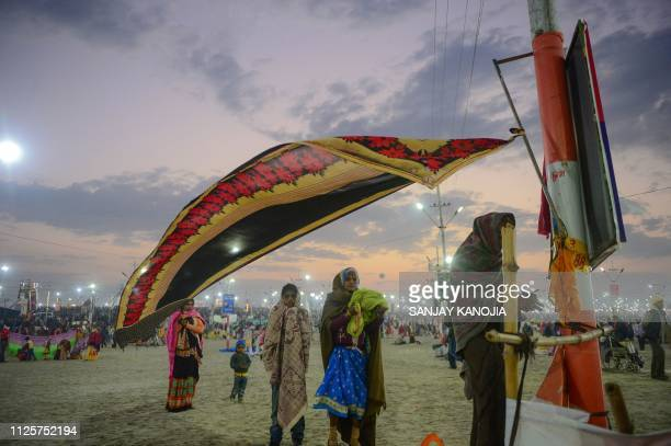 Indian Hindu devotees arrive at Sangam the confluence of the Ganges Yamuna and mythical Saraswati rivers on the auspicious day of 'Maghi Purnima'...