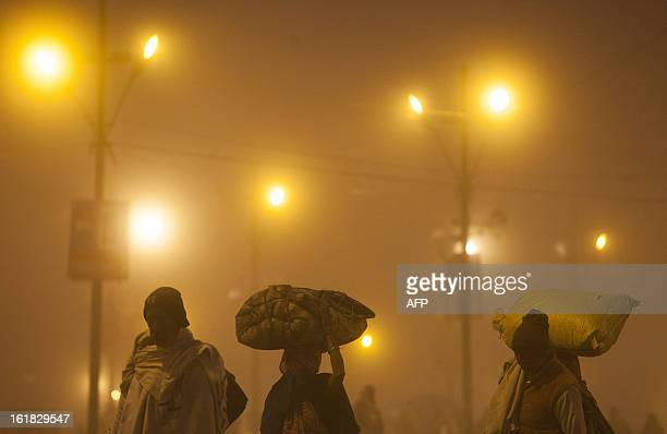 Indian Hindu devotees arrive early for prayers at the Sangam or confluence of the Yamuna Ganges and mythical Saraswati rivers during the Kumbh Mela...
