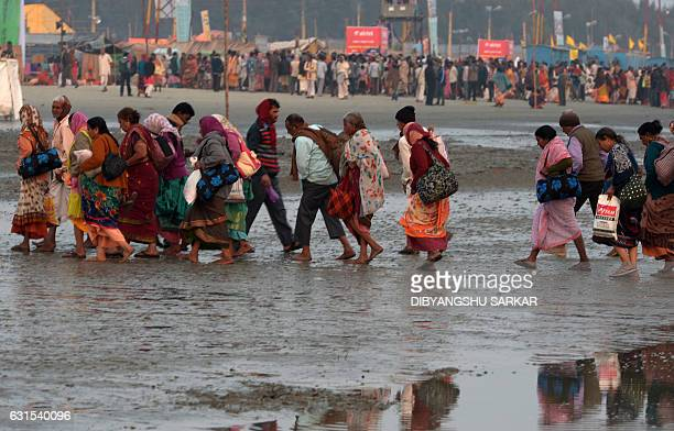 Indian Hindu devotees arrive to take a holy bath and perform rituals at the Gangasagar Island around 150 kms south of Kolkata on January 12 2017 More...