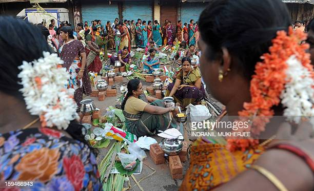 Indian Hindu devotees attend a community function on the occasion of Pongal in Mumbai on January 14 2013 Pongal is a thanksgiving or harvest festival...