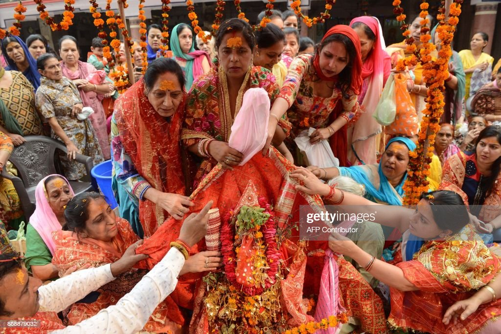 Indian Hindu devotees bless a tulsi plant as they celebrate a traditional Tulsi Vivah or TulsiShaligram wedding at a temple in Amritsar on November 1.