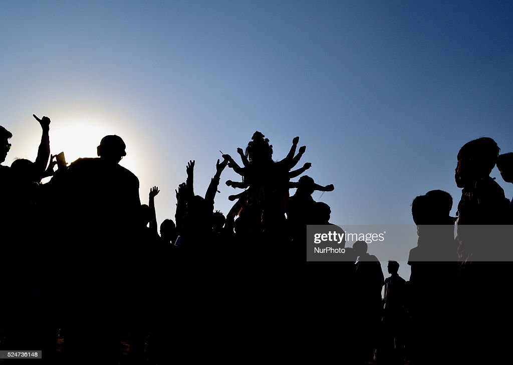 Indian Hindu devotees carry an idol of the goddess Durga to be immersed in a temporary pond near Sangam as part of the Durga Puja festival in...