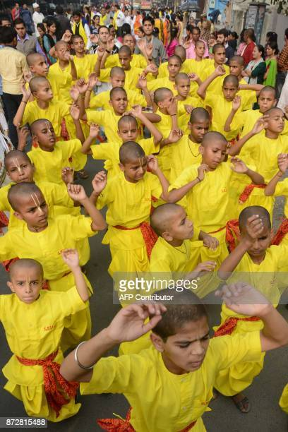 Indian Hindu devotees childrens dance and sing religious songs during the annual Jagannath Rath Yatra Festival in Amritsar on November 11 2017 The...