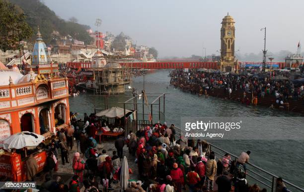 Indian Hindu devotees gather at a ghat of the River Ganges during Makar Sankranti, a day considered to be great religious significance in Hindu...