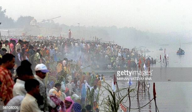 Indian Hindu devotees gather on the banks of the River Yamuna during the Chhat Festival in New Delhi, 07 November 2005 as they prepare to pray...