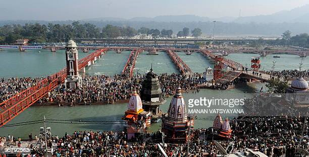 Indian Hindu devotees gather to offer prayers during the solar eclipse on the banks of river Ganges in Haridwar on January 15 during the Kumbh Mela...