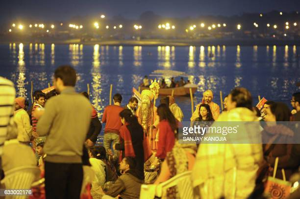 TOPSHOT Indian Hindu devotees gather to perform evening prayers at Sangam during the annual 'Magh Mela' festival in Allahabad on January 29 2017 /...