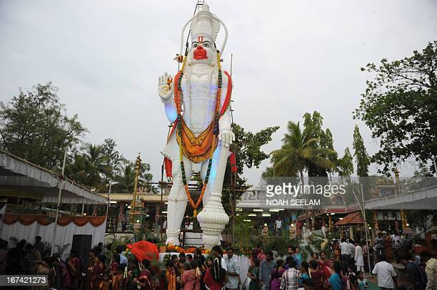 Indian Hindu devotees gathered around a 45 foot statue of Hindu God Hanuman during a unveiling ceremony in Hyderabad on April 25 on the occasion of...