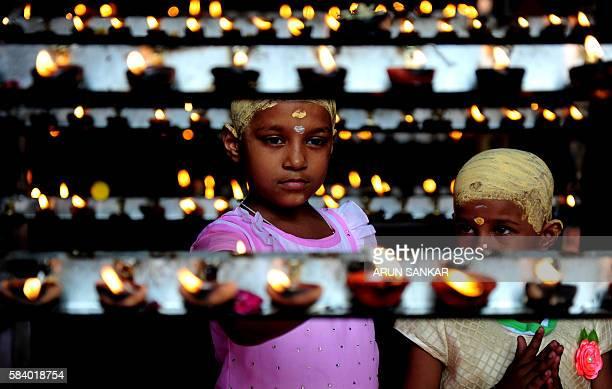TOPSHOT Indian Hindu devotees light candles during 'Aadi Kiruthigai' celebrations at Vadapazhni Murugan temple in Chennai on July 28 2016 Aadi is...
