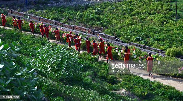 Indian hindu devotees moves for their Kanwar yatra on the first day of sacred month of Shravan in Allahabad on August 12015 The Yatra takes place...