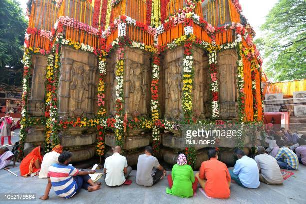 TOPSHOT Indian Hindu devotees offer prayer on occasion of 'Durga Puja' festival at Kamakhya Temple in Guwahati on October 15 2018 The fiveday 'Durga...