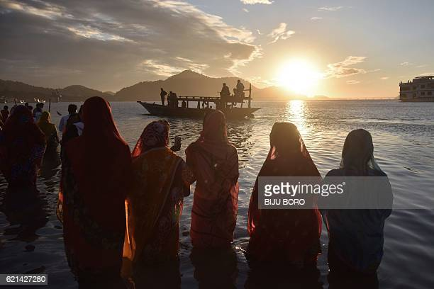 Indian Hindu devotees offer prayers during the Chhath Festival on the banks of the Brahmaputra River in Guwahati on November 6 2016 The Chhath...
