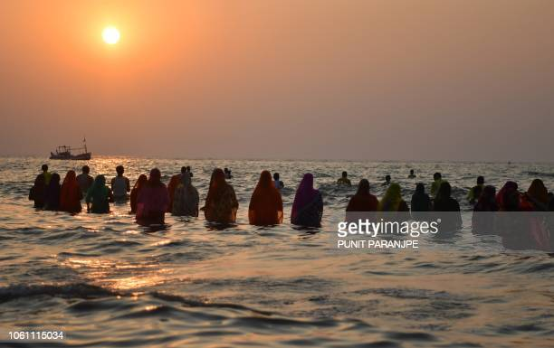 Indian Hindu devotees offer prayers near the sea front during the Chhath festival in Mumbai on November 13 2018 The Chhath Festival also known as...