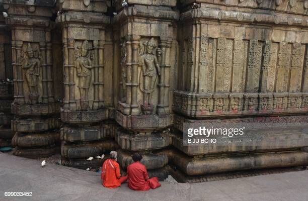 TOPSHOT Indian Hindu devotees offer prayers on the eve of the annual Ambubachi festival at the Kamakhya Temple in Guwahati on June 21 2017 Thousands...
