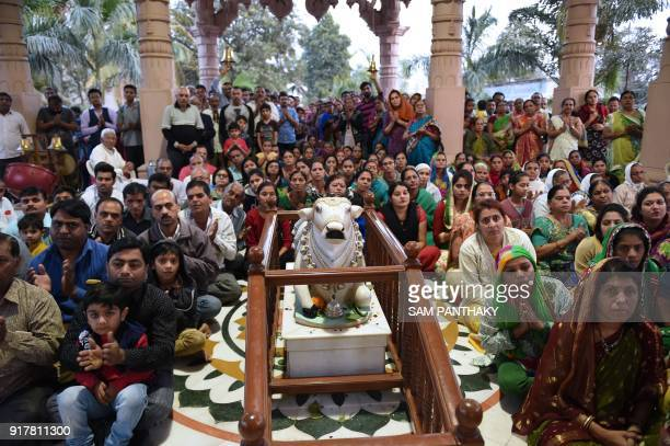 Indian Hindu devotees offer prayers to mark the Hindu Festival 'Maha Shivratri' at Vahelal village some 30 kms from Ahmedabad on February 13 2018 /...