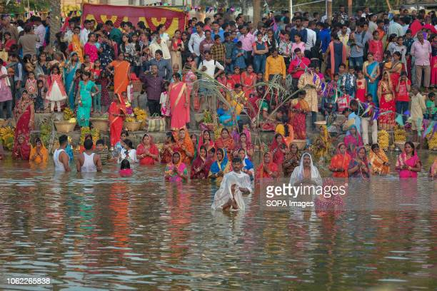 Indian Hindu devotees offer prayers to Sun God while standing in a water body on the occasion of Chhat Puja festival in Agartala Chhath an ancient...