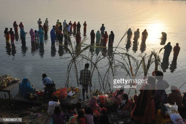 TOPSHOT Indian Hindu devotees offer prayers to the sun during the Chhath festival on the banks of the Hussain Sagar Lake in Hyderabad on November 13...