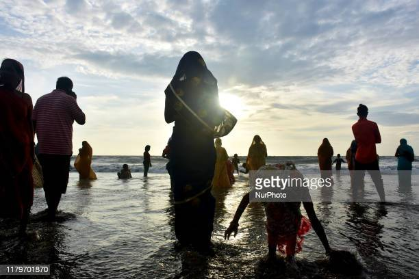 Indian Hindu devotees offer prayers to the Sun on the occassion of Chhath Puja festival at Juhu Beach on November 02 in Mumbai