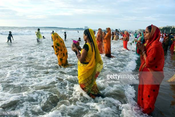 Indian Hindu devotees offer prayers to the Sun on the occassion of Chhath Puja festival at Juhu Beach on November 02 in Mumbai.