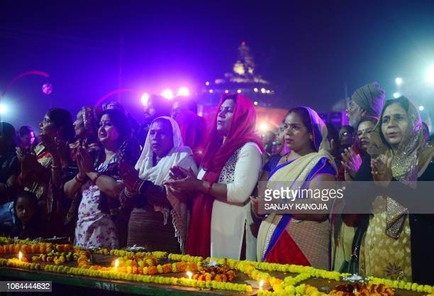 Indian Hindu devotees perform prayers at the Sangam area during 'Dev Deepawali' festival celebrations in Allahabad on November 23 2018 'Dev...