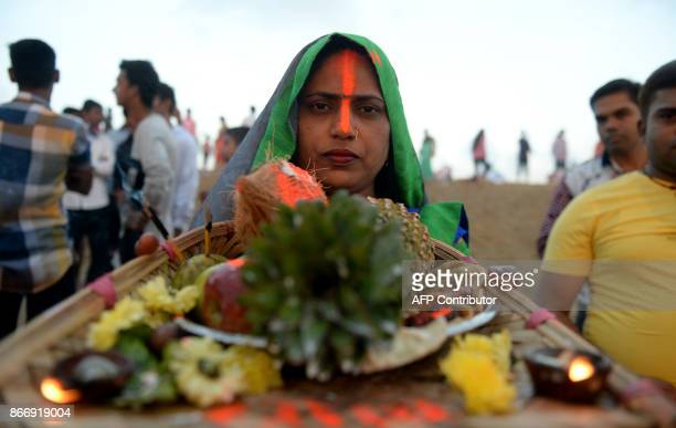 Indian Hindu devotees perform rituals during the Chhath Puja in Chennai on October 27 2017 The Chhath Festival also known as Surya Pooja or worship...
