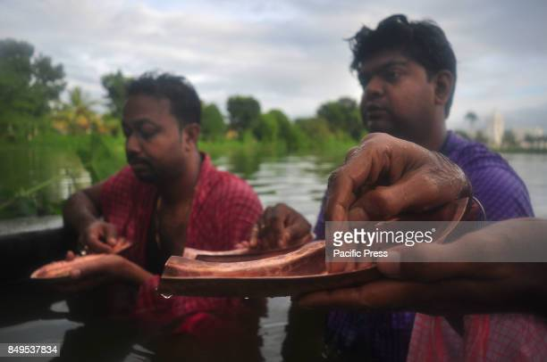 Indian Hindu devotees performs Tarpan a ritual to pay obeisance to one's forefathers on the last day for offering prayers to ancestors called...