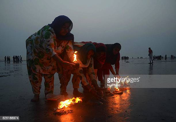 Indian Hindu devotees praying at the Gangasagar Island around 160 km south of Kolkata, India on Tuesday,12th January , 2016. Hindu devotees and monks...