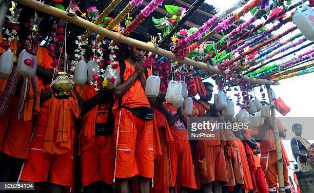 Indian hindu devotees prepare for Kanwar yatra as they worship before startting this sacred Yatra on the sacred month of Shravan at Daraganj Ghat in...