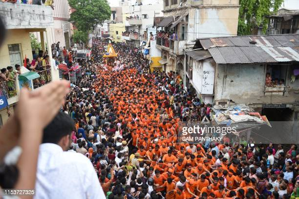 Indian Hindu devotees pull a chariot carrying the icon of Lord Jagannath in Raipur area during the 142nd annual Rath Yatra of Lord Jagannath in...