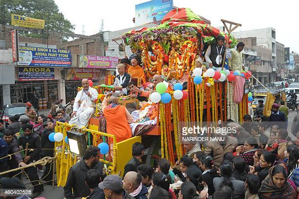 Indian Hindu devotees pull a chariot of Lord Jagannath his brother Balabhadra and sister Subhadra as people gather at the annual Jagannath Rath Yatra...