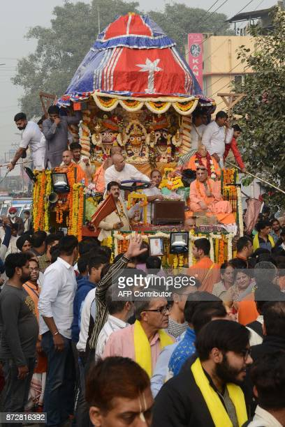 Indian Hindu devotees pull a chariot of the deity Lord Jagannath his brother Balabhadra and sister Subhadra during the annual Jagannath Rath Yatra...