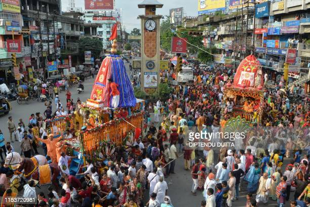 Indian Hindu devotees pull a float symbolising Lord Jagannath's chariot during Rath Yatra celebrations in Siliguri on July 4 2019 This year marks the...