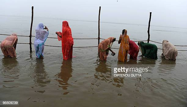 Indian Hindu devotees take a holy dip on the occasion of 'Paush Purnima' the first bath of The 'Magh Mela' festival at Sangam the confluence of the...