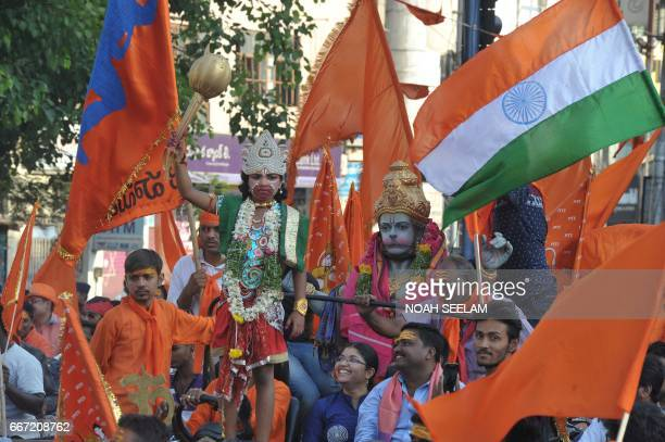 Indian Hindu devotees take part in a procession to mark Hanuman Jayanti the birthday of the Hindu monkeygod Lord Hanuman in Hyderabad on April 11...