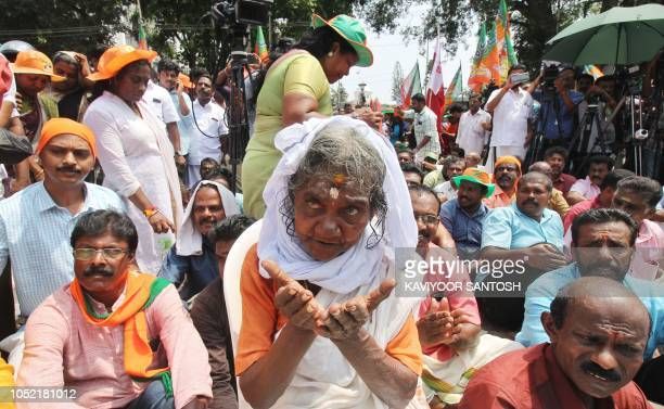 TOPSHOT Indian Hindu devotees take part in a protest against a Supreme Court verdict revoking a ban on women's entry to a Hindu temple in...