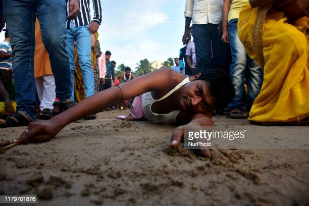 Indian Hindu devotees take part in the rituals of Chhath Puja festival at Juhu Beach on November 02 in Mumbai