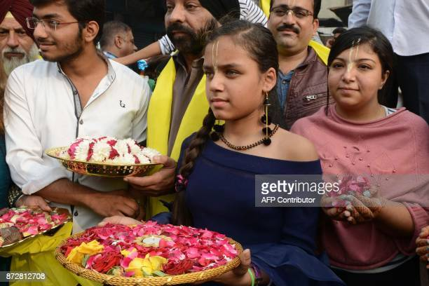 Indian Hindu devotees wait to throw rose petals during the annual Jagannath Rath Yatra Festival in Amritsar on November 11 2017 The three deities of...