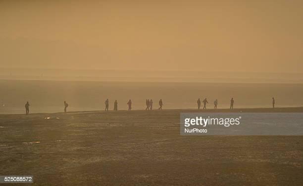 Indian hindu devotees walk to take a holy dip at sangamconfluence of River GangaYamuna and mythical saraswati during holy month of Kartikain...