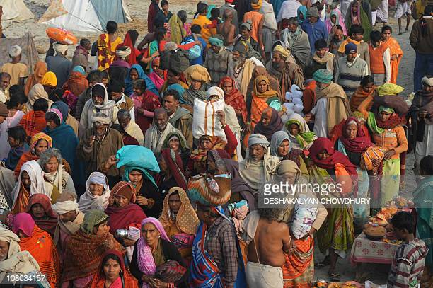 Indian Hindu pilgrims make their way towards the waters of the Gangasagar some 180 Kms south of Kolkata on early January 14, 2011 during the hold...