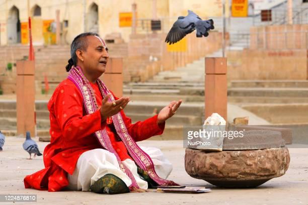 Indian hindu priest offers prayers on the occasion of ''Guru Purnima'' on the holy lake of Pushkar, Rajasthan, India on 05 July 2020. Hindu devotees...