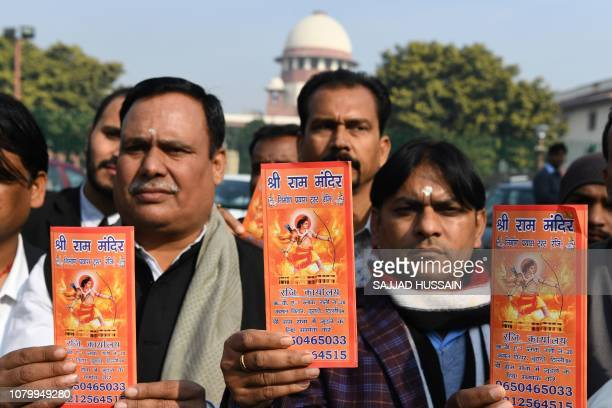 Indian Hindu protesters hold leaflets with the picture of Lord Ram outside the Indian Supreme Court in New Delhi on January 10 after the hearing in...